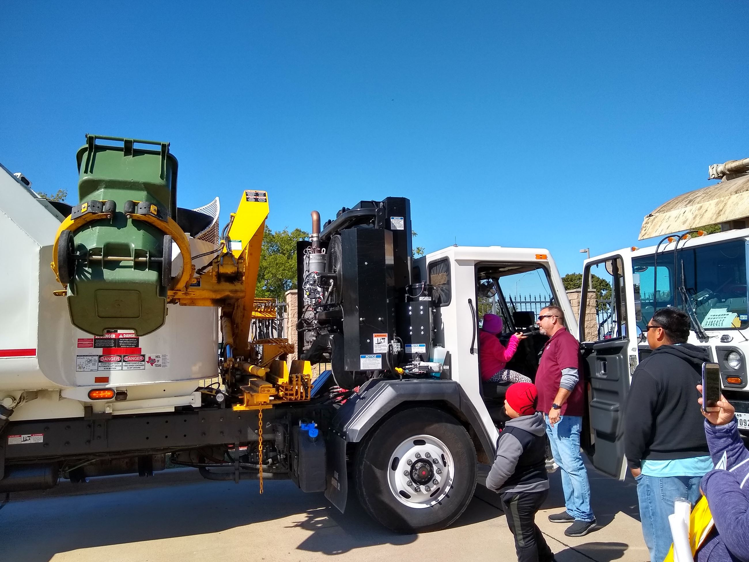 EWS driver assists children in recycle truck at City of Garland event