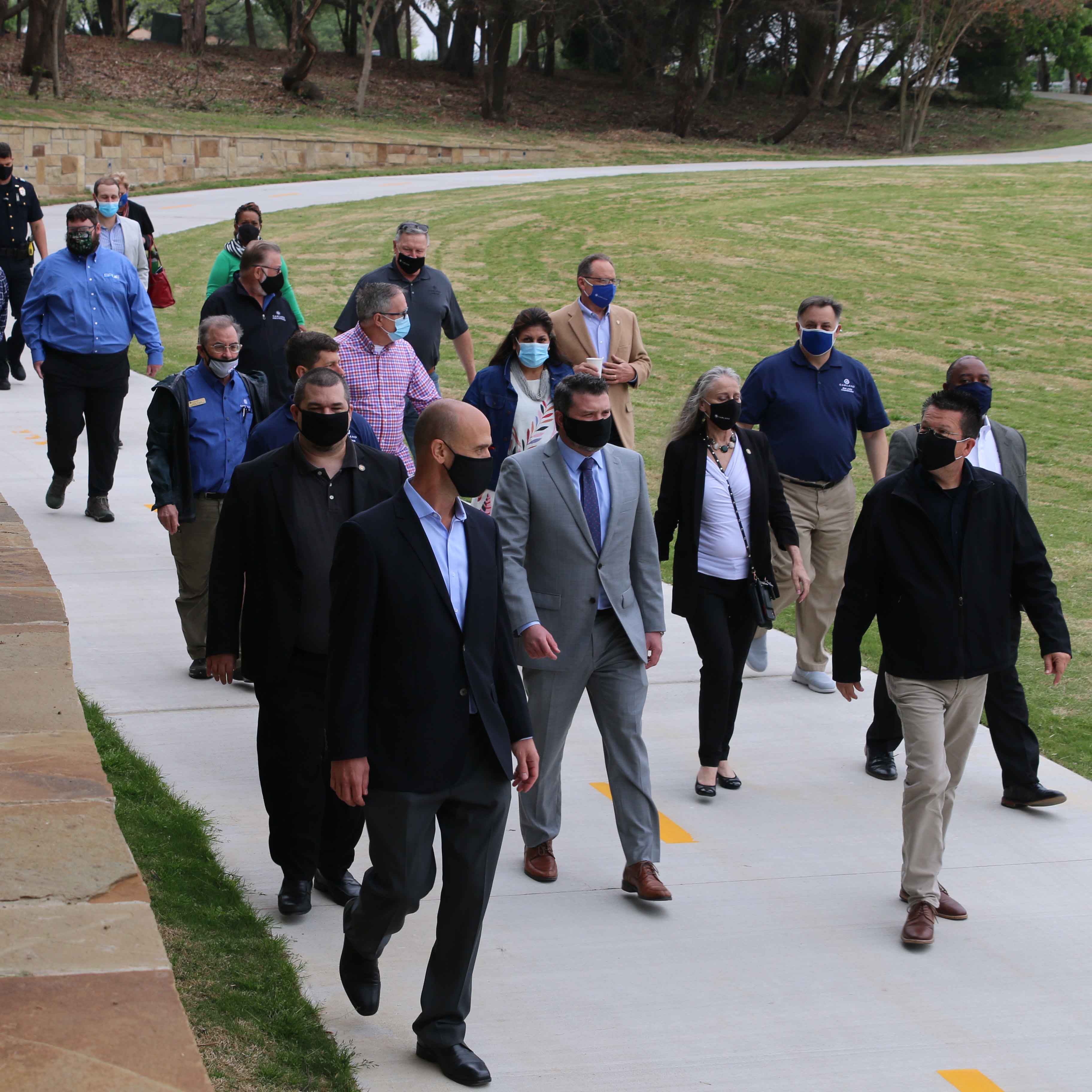 Garland City Council members and Dallas County partners tour new trails in Winters Park.